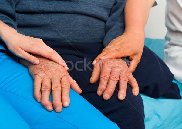 Supporting The Elderly With Parkinson's Disease Stock photo © barabasa