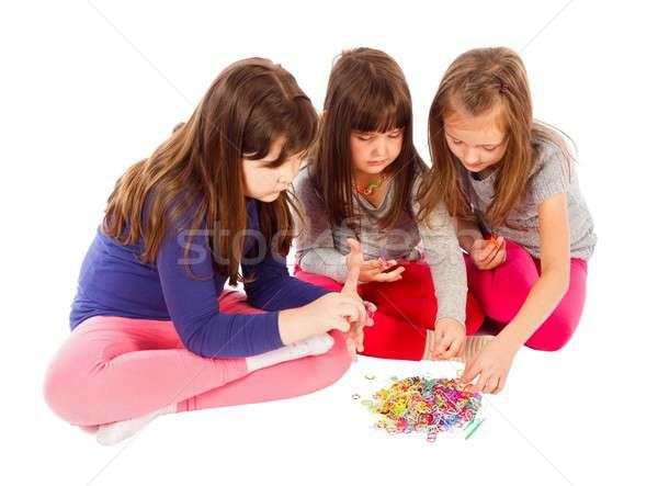 Együtt idősebb nővérek magyaráz kicsi egy Stock fotó © barabasa