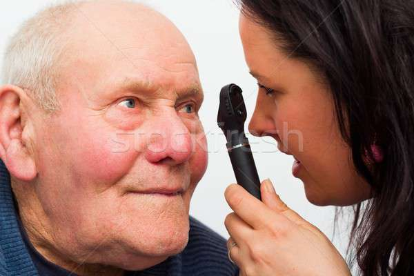 Elderly Man With Vision Problems Stock photo © barabasa