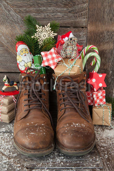 Stock photo: Boots with christmas presents