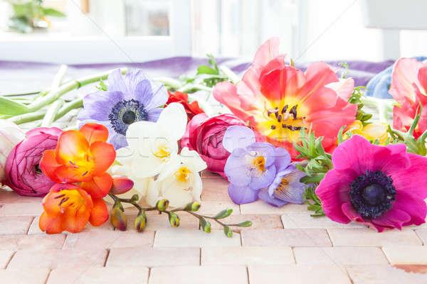 Colorido flores da primavera rústico pedra telha flores Foto stock © BarbaraNeveu