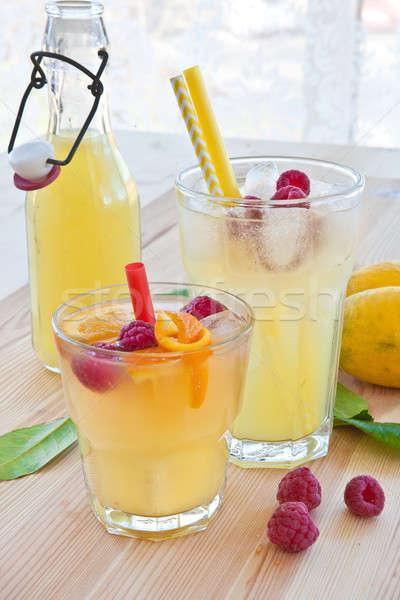 Stock photo: Cold lemonade with fresh lemons