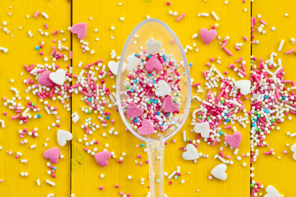 Colorful sprinkles on yellow Stock photo © BarbaraNeveu