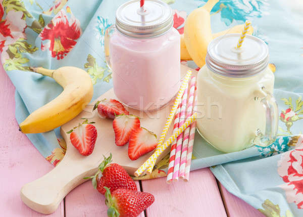 Milk with fresh strawberries and bananas Stock photo © BarbaraNeveu