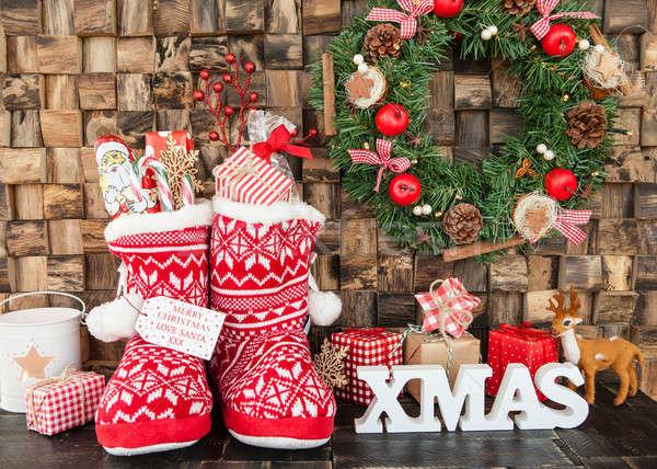 Kicsi kötött csizma ajándékok piros csemegék Stock fotó © BarbaraNeveu