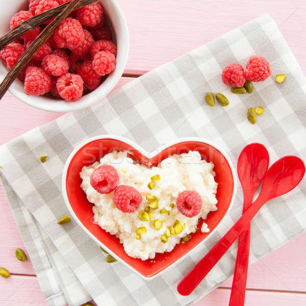 Pudim de arroz framboesas tigela fresco comida coração Foto stock © BarbaraNeveu