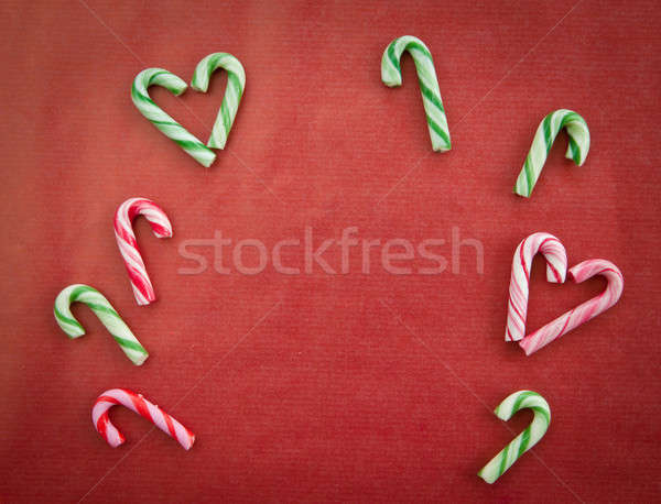 Candy canes on red  Stock photo © BarbaraNeveu