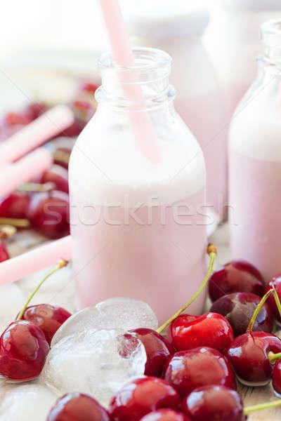 Stock photo: Creamy milk shake with cherries