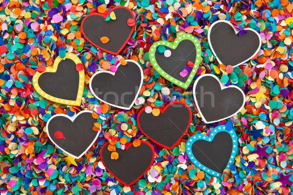 Stok fotoğraf: Küçük · kalpler · konfeti · kara · tahta · sevmek · doğum · günü