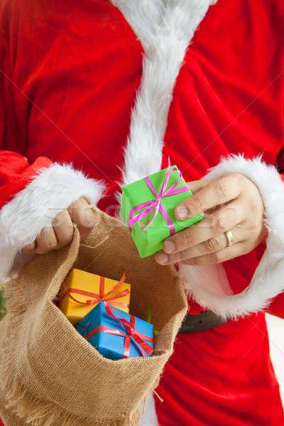 Santa Claus handing out presents Stock photo © BarbaraNeveu
