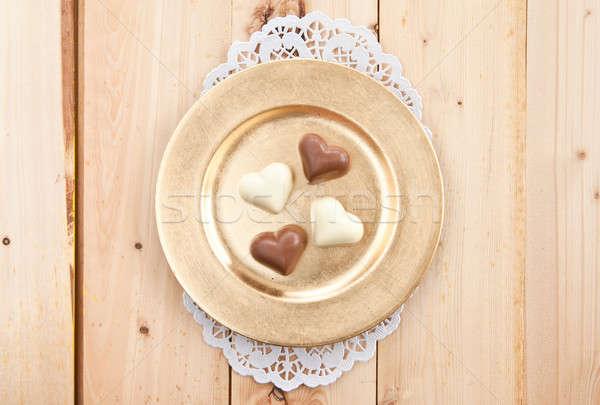 Csokoládé szívek különböző arany tányér szeretet Stock fotó © BarbaraNeveu