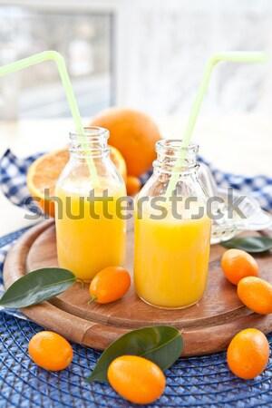 Orange juice in vintage jars Stock photo © BarbaraNeveu