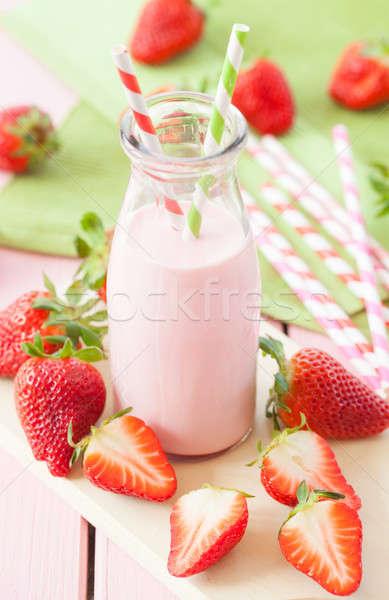 Stock photo: Milk with fresh strawberries
