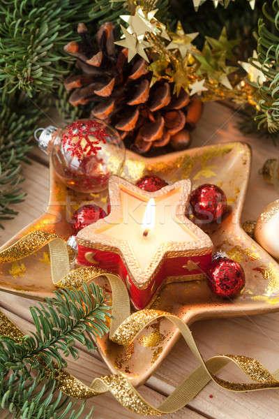 Candle and christmas decorations Stock photo © BarbaraNeveu
