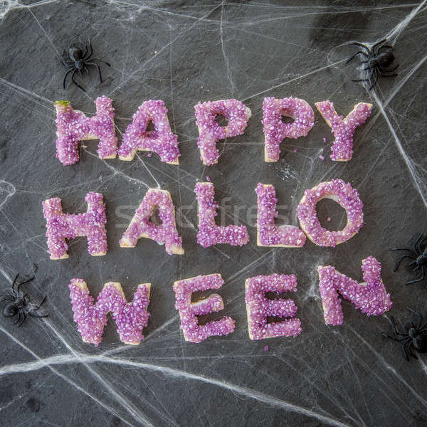 Stok fotoğraf: Mutlu · halloween · kurabiye · afiş · mor · şeker