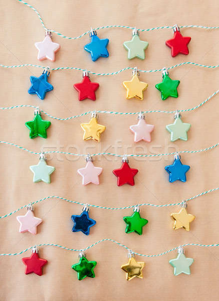 Stock photo: Colorful stars on brown paper