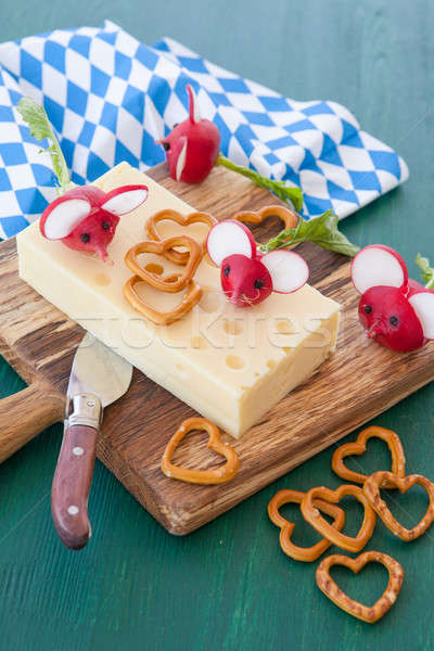 Block of hard cheese with radishes Stock photo © BarbaraNeveu