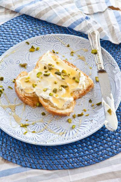 Brioche with cream cheese and honey Stock photo © BarbaraNeveu