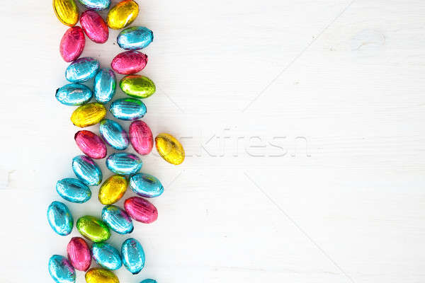 White wooden background with colorful easter eggs Stock photo © BarbaraNeveu