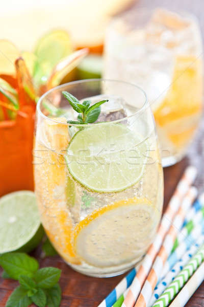 Stock photo: Cold drink with lemons and oranges