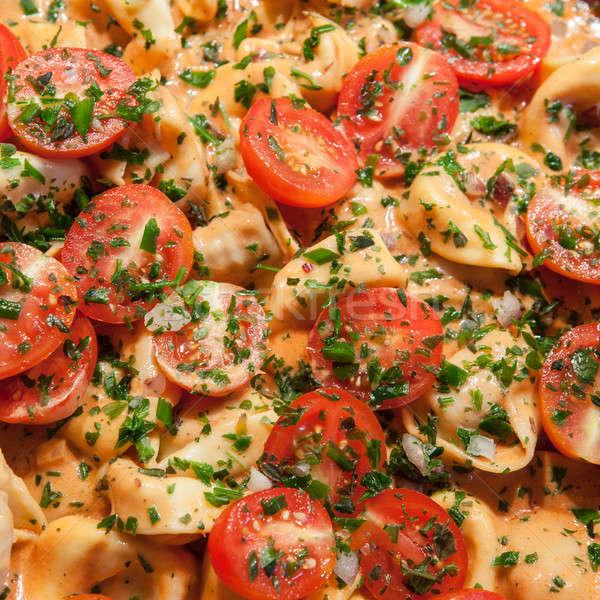 Tortellini friss paradicsomok koktélparadicsom bazsalikom étel Stock fotó © BarbaraNeveu