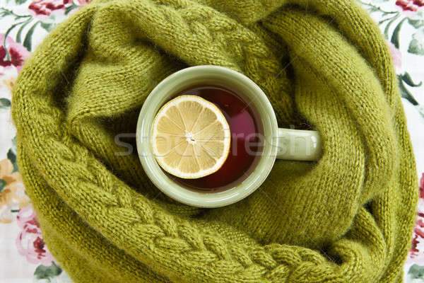 Cup of tea in warm scarf Stock photo © BarbaraNeveu