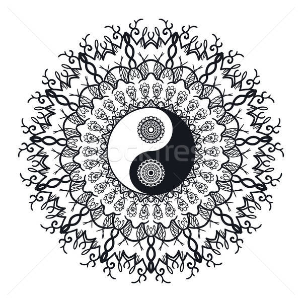 Vintage Yin and Yang in Mandala Stock photo © barsrsind