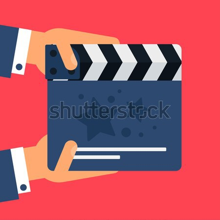 Flat movie clapperboard Stock photo © barsrsind