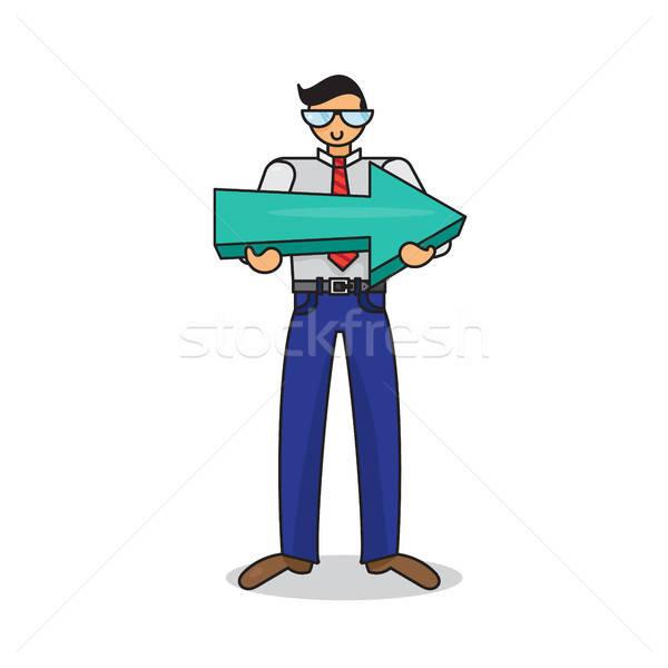 Employee with big arrow in hands Stock photo © barsrsind