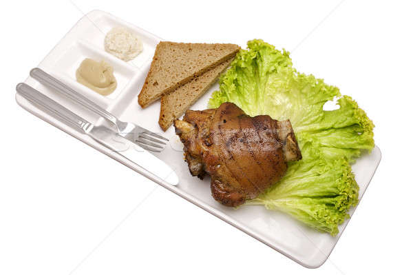 knuckle of pork on a plate Stock photo © bartekwardziak