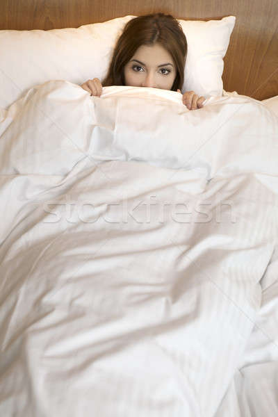 Above view of sleeping beautyful smiling brunet girl under white Stock photo © bartekwardziak