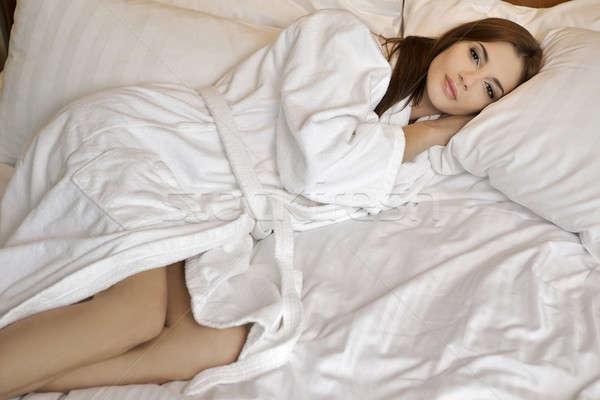 Young sleeping woman at bedroom Stock photo © bartekwardziak