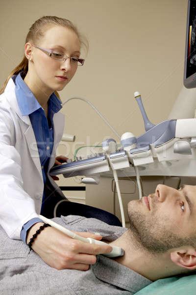 Portrait of young female technician operating ultrasound machine Stock photo © bartekwardziak