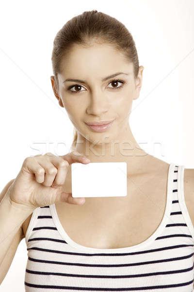 Beautiful smiling woman holding a membership card Stock photo © bartekwardziak