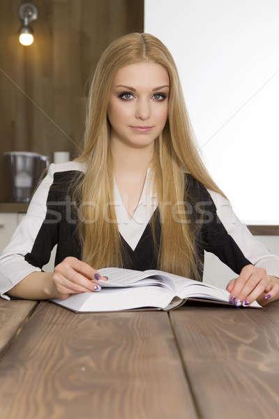 Portrait of clever student reading book Stock photo © bartekwardziak