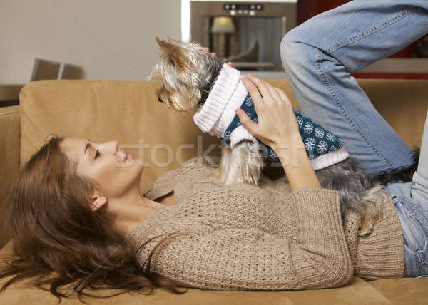 Cute young girl with her Yorkie puppy Stock photo © bartekwardziak