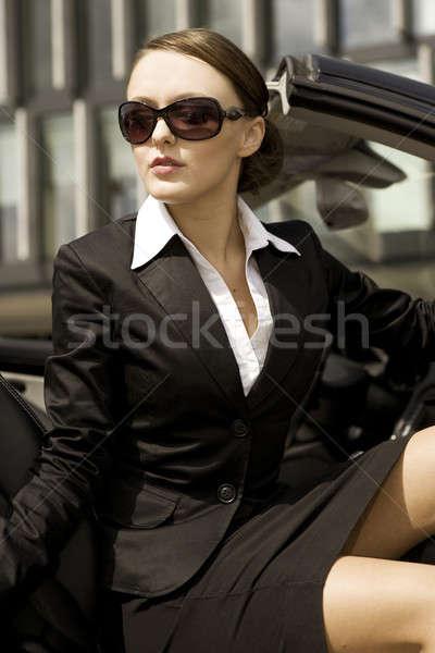 businesswoman in a cabrio Stock photo © bartekwardziak