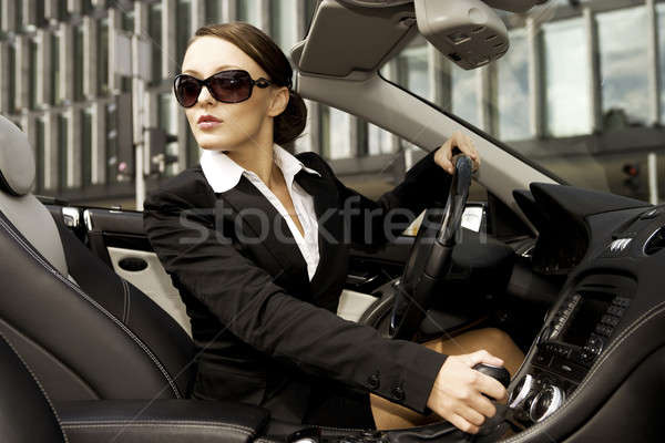 businesswoman driving a car Stock photo © bartekwardziak