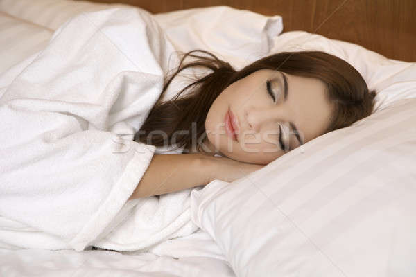 Closeup portrait of a cute young woman sleeping on the bed Stock photo © bartekwardziak