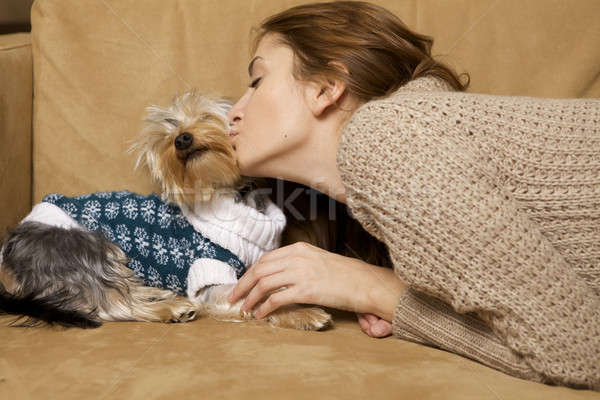 Cute young girl with her Yorkie puppy Stock photo © bartekwardziak