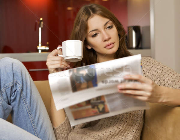 mid adult woman drinking coffee and reading news Stock photo © bartekwardziak