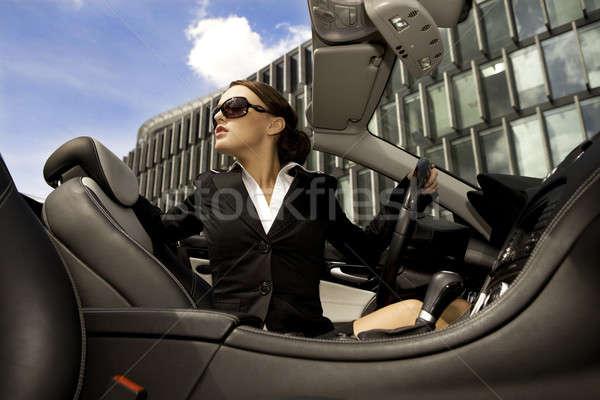 businesswoman driving a car Stock photo © bartekwardziak