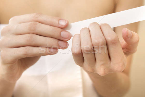 Woman polishing fingernails with the nail file Stock photo © bartekwardziak