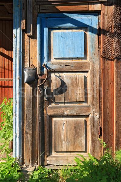Starzenie się drzwi drewna domu tle blokady Zdjęcia stock © basel101658