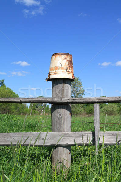 old pail on old fence Stock photo © basel101658