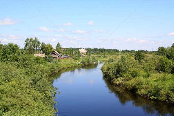 Stock photo: village on coast river