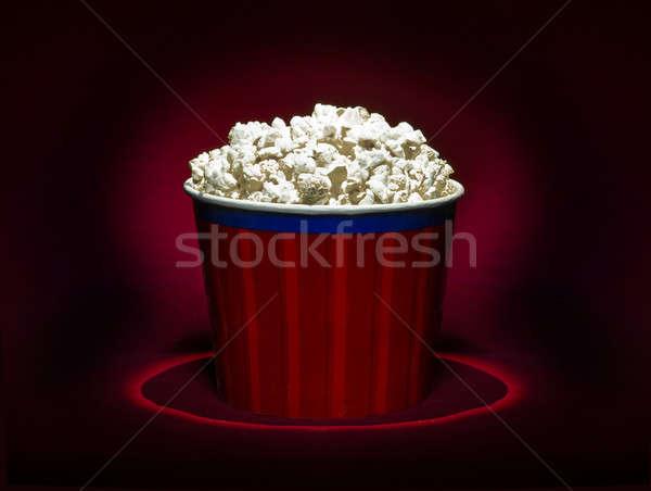 Pattogatott kukorica piros papír doboz mozi kukorica Stock fotó © bazilfoto