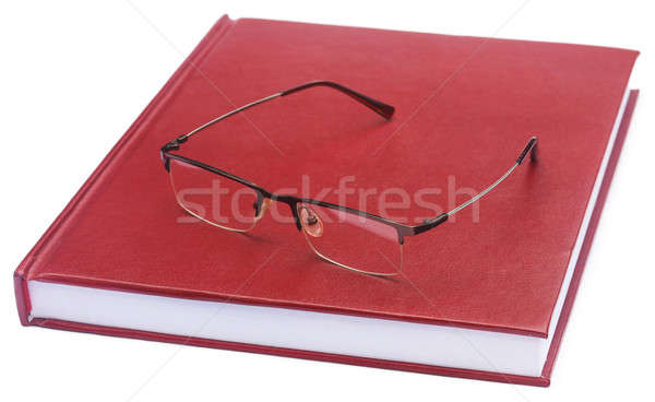 Maroon colored thesis paper with spectacles Stock photo © bdspn