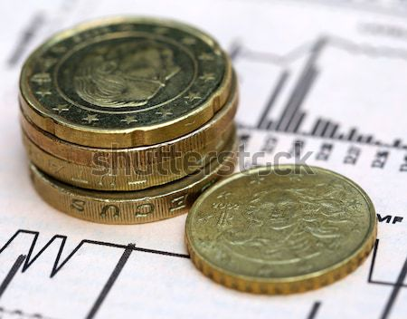 Currencies on graph with a pen Stock photo © bdspn