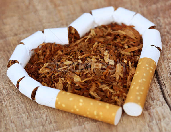 Dried tobacco leaves and cigarette Stock photo © bdspn
